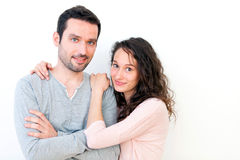 Portrait of a young happy couple on a white background Royalty Free Stock Images
