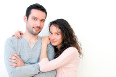 Portrait of a young happy couple on a white background Stock Photos