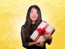 Portrait of young happy and excited beautiful Asian Chinese woman receiving a romantic anniversary gift box holding the. Red ribbon present cheerful for stock photos