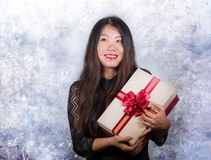 Portrait of young happy and excited beautiful Asian Japanese woman receiving a romantic anniversary gift box holding the. Red ribbon present cheerful for royalty free stock image