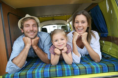 Portrait of young happy family in camping car stock photo
