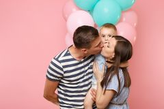 Portrait of young happy family, parents keep in arms, kissing hugging child kid son baby boy, celebrating birthday stock photography