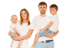 Portrait of young happy family with two children Royalty Free Stock Photography