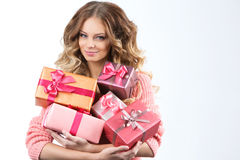 Portrait of a young happy girl with gift box in hands. Royalty Free Stock Photo