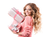 Portrait of a young happy girl with gift box in hands. Royalty Free Stock Photography