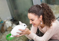 Portrait of young happy girl holding rabbit Royalty Free Stock Image