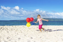 Portrait of young happy girl running by sand beach on se Stock Photos