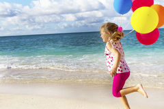 Portrait of young happy girl running by sand beach on se Royalty Free Stock Photography