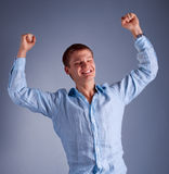 Portrait of young happy man. With raised hands Stock Photos