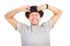 Portrait of young happy man in hat. On white background Stock Photo