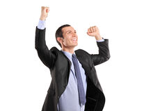 Portrait of a young happy man with raised hands Stock Photography
