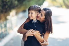 Portrait of a young happy mother and her little son. stock images
