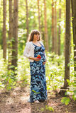 Portrait of young happy pregnant woman relaxing and enjoying life in nature. Outdoor shot. Royalty Free Stock Photography