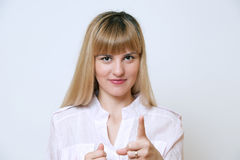 Portrait of young happy smiling business woman pointing finger a Royalty Free Stock Photos
