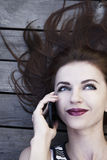 Portrait of young happy smiling businesswoman with smartphone outdoors as symbol of good news, freelance, success and wealth stock photos