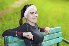 Portrait of Young Happy Smiling Female Athlete Having a Break in Stock Photo