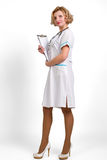 Portrait of young happy smiling female doctor with clipboard iso Stock Photo
