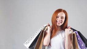 Portrait of young happy smiling girl with shopping bags. Slow Motion stock footage