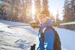Portrait of young happy smiling skier, winter holidays. Portrait of young happy smiling skier in goggles, active winter holidays Royalty Free Stock Images