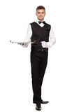 Portrait of young happy smiling waiter with on tray isolated on Stock Image