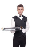 Portrait of young happy smiling waiter with on tray isolated on royalty free stock photography