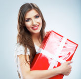 Portrait of young happy smiling woma red gift box hold. Stock Photos