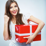 Portrait of young happy smiling woma red gift box  Stock Photos
