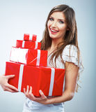 Portrait of young happy smiling woma red gift box hold. Stock Images