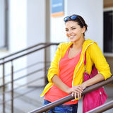 Portrait of young happy smiling woman with bag Stock Photography