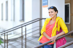 Portrait of young happy smiling woman with bag Royalty Free Stock Image