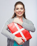 Portrait of young happy smiling woman hold gift box.Smiling gir Stock Images