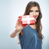 Portrait of young happy smiling woman hold red gift box. Isolat Stock Image