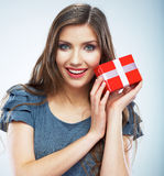 Portrait of young happy smiling woman hold red gift box. Isolat. Portrait of casual young happy smiling woman hold red gift box. Isolated studio background Royalty Free Stock Image