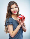 Portrait of young happy smiling woman hold red gif Royalty Free Stock Photos