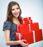 Portrait of young happy smiling woman hold red gift box. Isolat Royalty Free Stock Photos