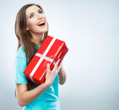Portrait of young happy smiling woman hold red gif Royalty Free Stock Image
