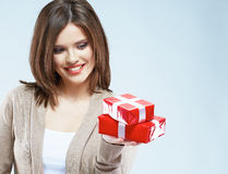 Portrait of young happy smiling woman hold red gift box. Isolat Stock Photography