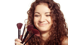 Portrait of smiling woman with make up tools Stock Photography