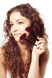 Portrait of smiling woman with make up tools Royalty Free Stock Photo
