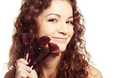 Portrait of smiling woman with make up tools Stock Photos