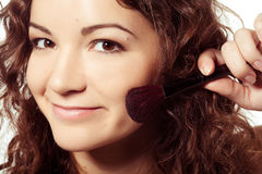 Portrait of smiling woman with make up tools Royalty Free Stock Photography