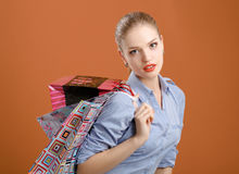Portrait of young happy smiling woman with shopping bags Stock Photography