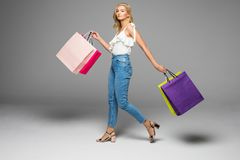 Portrait of young happy smiling woman with shopping bags black friday shopping. royalty free stock photos