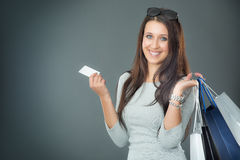 Portrait of young happy smiling woman with shopping bags credit card and shoes Royalty Free Stock Photos