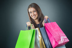 Portrait of young happy smiling woman with shopping bags credit card and shoes Stock Photos