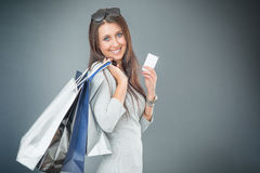 Portrait of young happy smiling woman with shopping bags credit card and shoes Stock Image