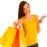 Portrait of young happy smiling woman with shopping bags, isolat Royalty Free Stock Image