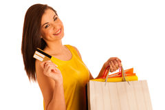 Portrait of young happy smiling woman with shopping bags, isolat Royalty Free Stock Images
