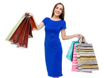 Portrait of young happy smiling woman with shopping bags Stock Image