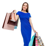 Portrait of young happy smiling woman with shopping bags Royalty Free Stock Photography